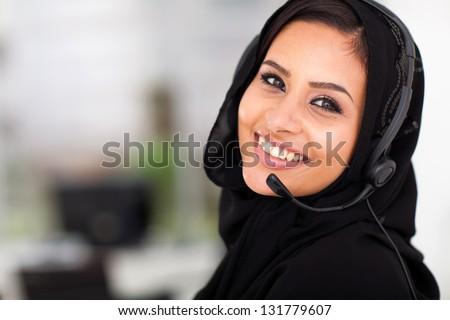 pretty Arabian call center operator closeup portrait
