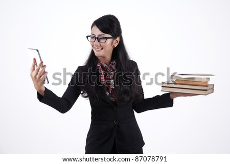 Pretty Asian Business Woman with a digital tablet and stack of books