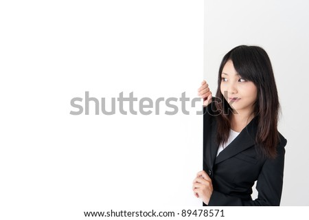 pretty asian businesswoman with blank whiteboard