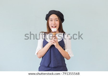 Pretty Asian girl or young Asian woman eating junk food (woman eat ice cream) by not fear or not mind about fat and calories (diet or loss weight concept)
