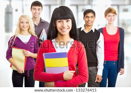 Pretty asian girl student and her diversity friends on background