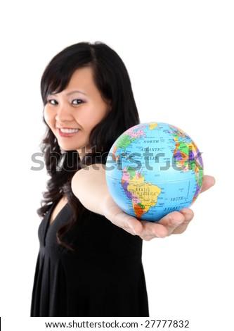 Pretty asian woman holding globe of world