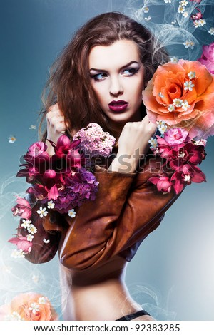 pretty attractive erotic woman in brown jacket with big flowers - stock photo