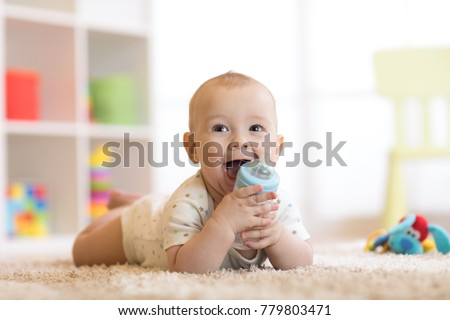 pretty baby boy drinking water...