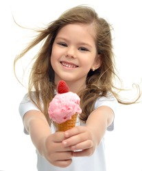 Pretty baby girl kid holding ice cream in waffles cone with raspberry showing happy smiling isolated on a white background