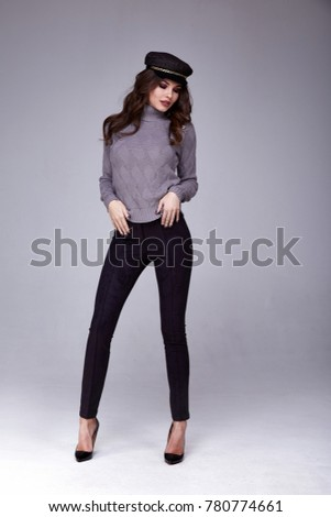 Pretty beautiful sexy woman wear wool knitted sweater and black pants skinny body shape lady boss business woman skin tan long brunette hair party style fashion cloches accessory hat shoes studio.