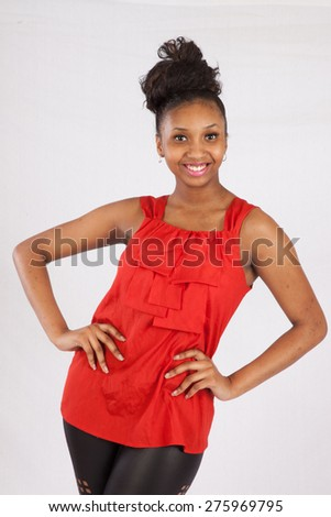 Pretty black woman in orange blouse, with a happy smile #275969795