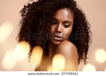 pretty black woman's portrait with bokeh #297498461