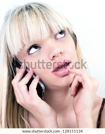 pretty blond girl pondering while phoning