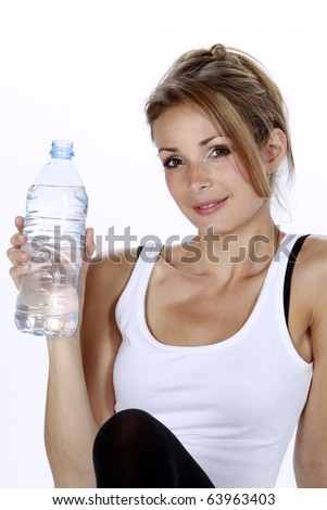 Pretty blond lady making sport and driking water isolated in a white background
