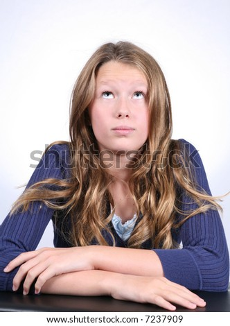 pretty blond preteen in blue girl looking up