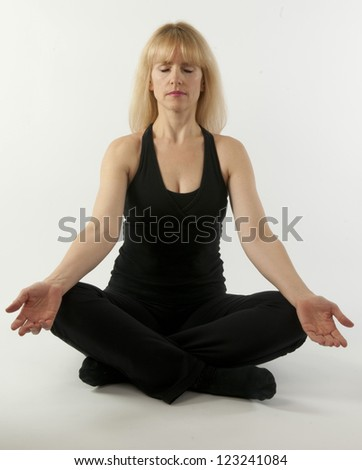 Pretty  blond woman doing yoga stretching exercise