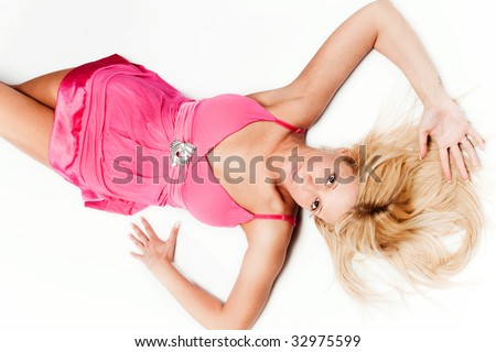 pretty blond woman in pink dress, studio white background