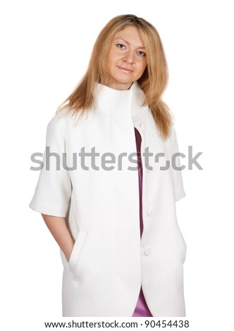 Pretty blond woman on white backdrop in white coat