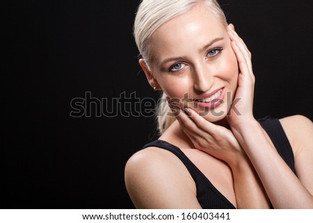 pretty blond woman posing on black background