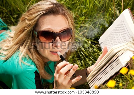 pretty blond woman reading , and evaporated to an electric cigarette