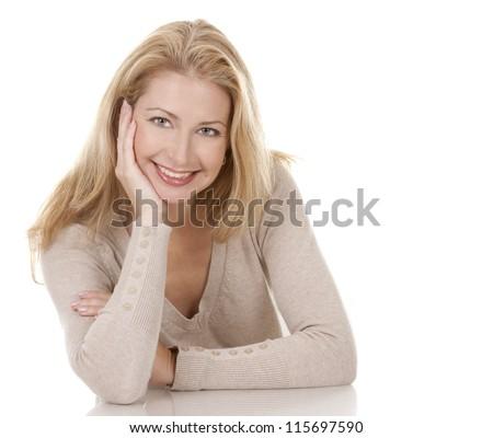 pretty blond woman wearing beige top sitting on white background