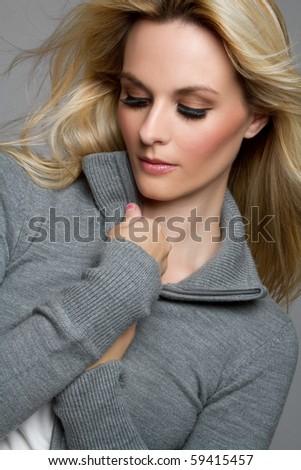 Pretty blond woman wearing sweater