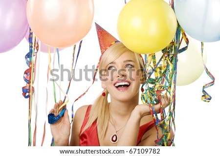 Pretty blond woman with funny hat and balloons during a party over white smiling and looking up
