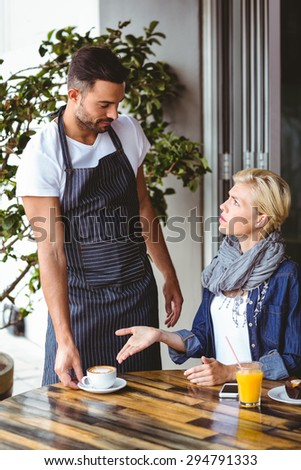 Pretty blonde arguing with the waiter at the cafe