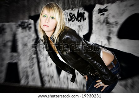 Pretty Blonde Girl against Graffiti Background