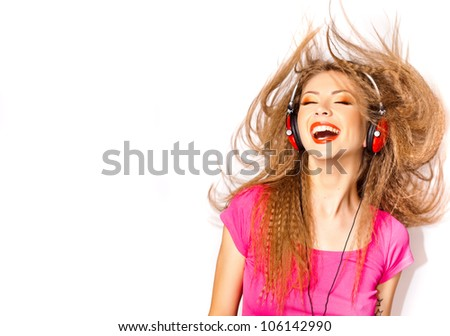pretty blonde girl laughing while listening music on big red headphones isolated on white - copy space