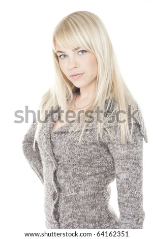 Pretty blonde girl posing in winter clothes