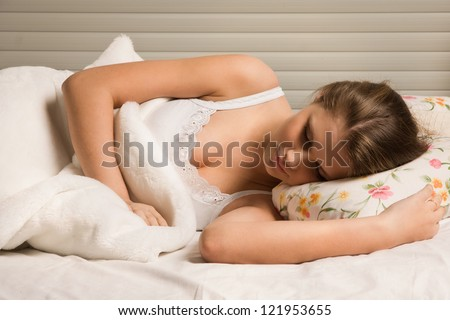 Pretty blonde girl sleeping on the bed