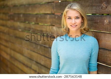 Pretty blonde single woman portrait outdoors nice teeth and hair