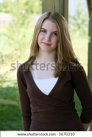 stock photo : pretty blonde teen girl with brown eyes standing outside