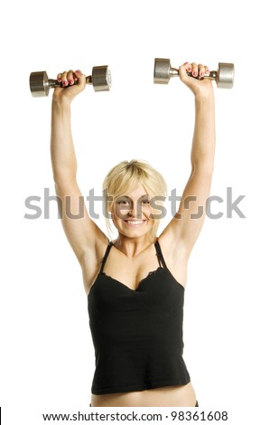 Pretty blonde woman lifting weights above her head smiling isolated on a white background