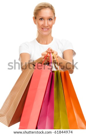 Pretty blonde woman with shopping bags isolated on white