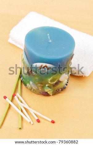 Pretty Blue Shell Candle with Matches on Table