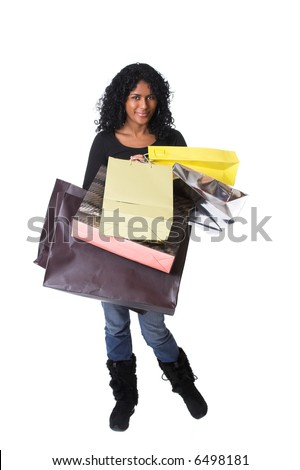 Pretty brazilian girl packed with shopping bags