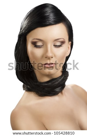 pretty brunete girl with long hair around the neck, she is in front of the camera and looks down