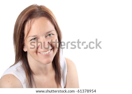 Pretty brunette adult woman in her early forties smiling happily on a white background