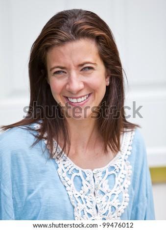 Pretty brunette adult woman portrait smiling outside