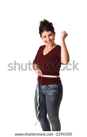 pretty brunette being very happy while holding a measuring tape around her waist showing that she lost some centimeters