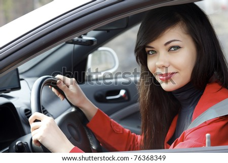 Pretty brunette driving a car