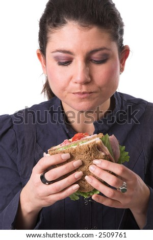 Pretty brunette focused completely on her healthy tasty sandwich, ready to take a bite