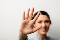 Pretty brunette girl showing five fingers