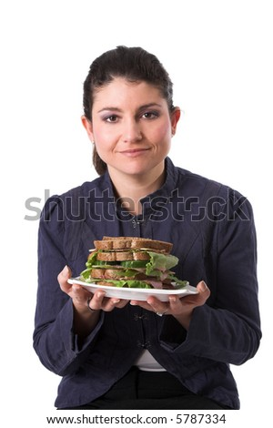 Pretty brunette holding a plate with a healthy sandwich