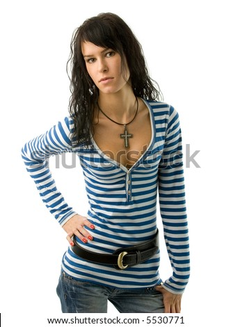 Pretty brunette in blue jeans and striped t-shirt posing in studio / isolated over white background