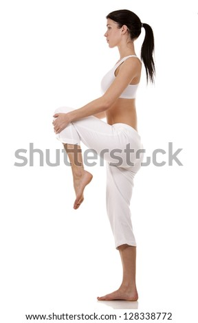 pretty brunette in white active wear on white background