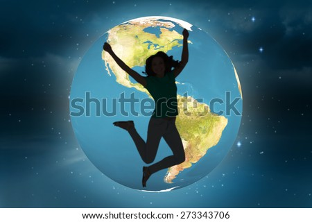 Pretty brunette jumping and smiling against stars twinkling in night sky