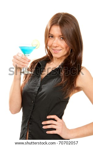 Pretty brunette slim woman holds popular blue tropical martini cocktail with lime in right hand in black shirt thinking and looking up isolated on a white background