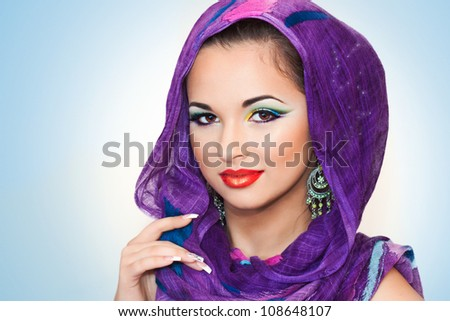pretty brunette smiling and having an oriental makeup