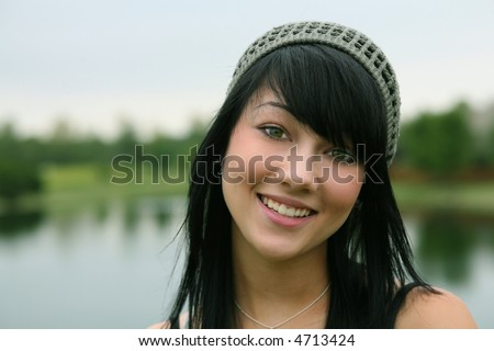 stock photo : pretty brunette teen girl smiling closeup