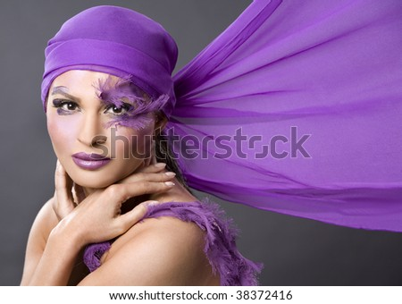stock photo : pretty brunette wearing purple outfit and matching makeup