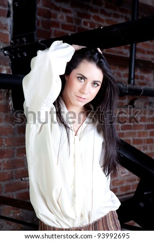 Pretty Brunette with Long Black Hair wearing 70s clothing - stock